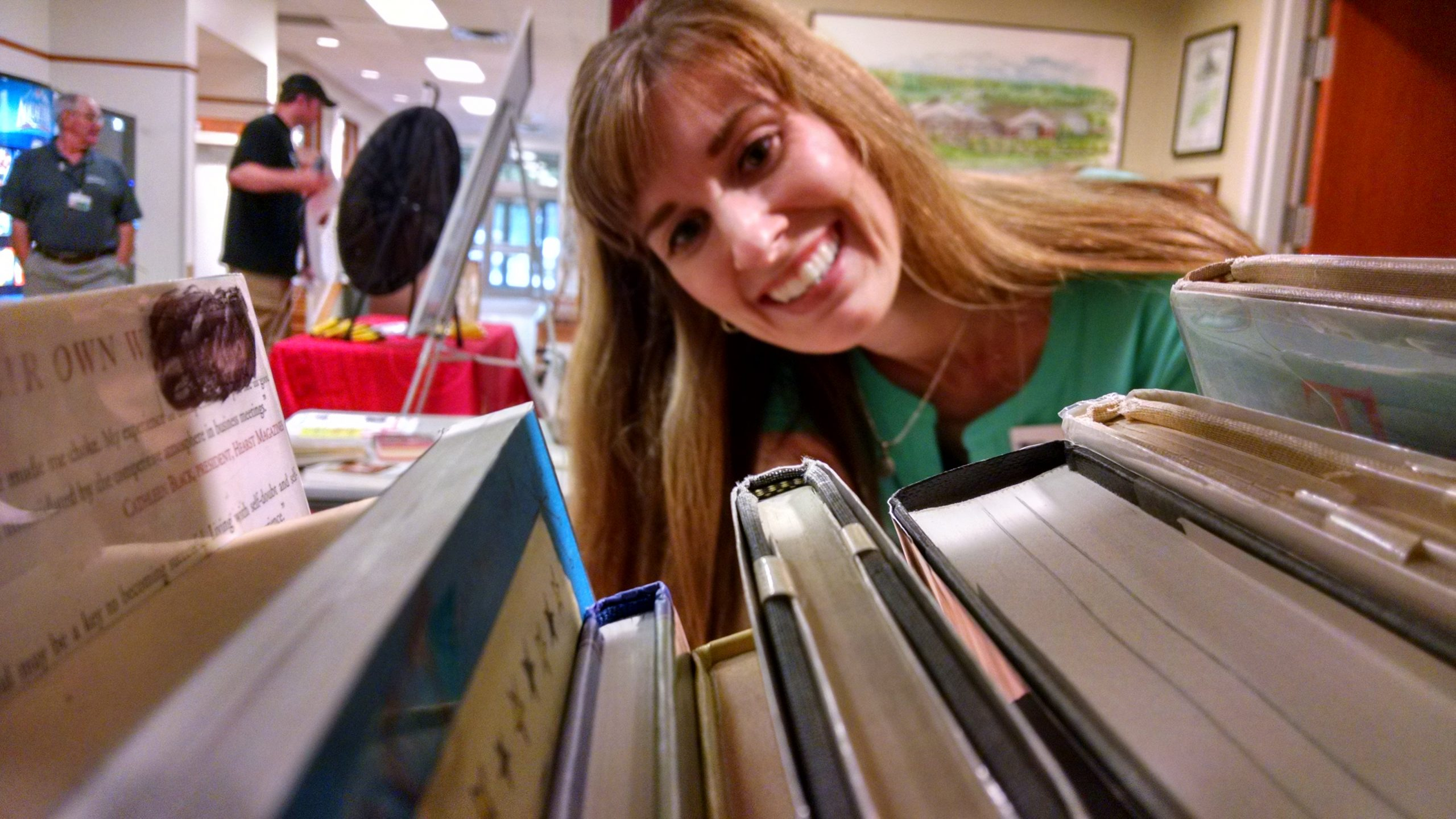 A music lover browses the Pop-Up Library during a Mentor Rocks concert.